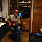 Dick playing guitar
